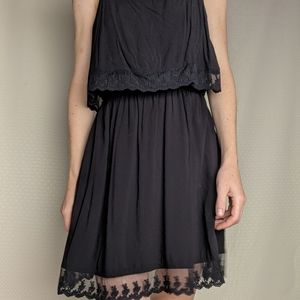 Cute black dress with pockets and lace trim